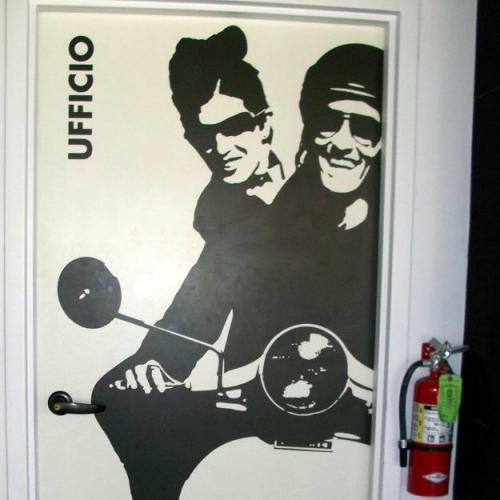 Photo - door with couple on vespa
